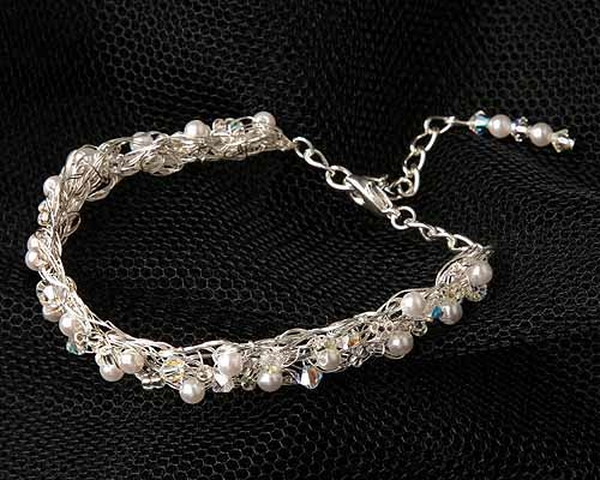 A combination of soft pearls and glittering crystals on a silver tone wire